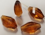 TOPAZ 20X12MM MULTI FACETED TWISTED BEADS - Lots of 12
