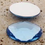 Light Sapphire Faceted - 40x30mm. Oval Cabochons - Lots of 12