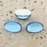 Light Sapphire Jewel - 25x18mm. Oval Cabochons - Lots of 72